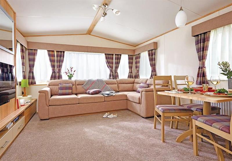 Living room at the Superior Caravan 2 at Viewfield Manor Holiday Park in Kilwinning, Ayrshire