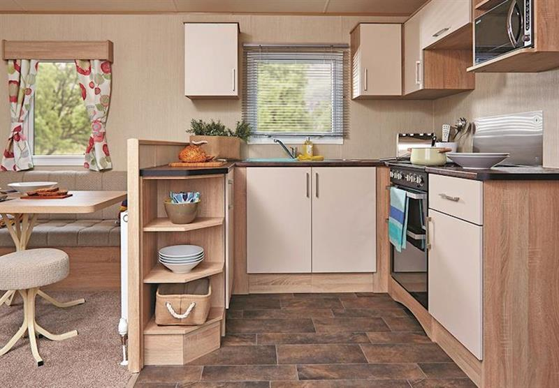 The kitchen area in Superior Caravan 2 at Viewfield Manor Holiday Park in Kilwinning, Ayrshire