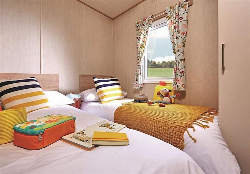 Twin bedroom in Superior Caravan 2 at Viewfield Manor Holiday Park in Kilwinning, Ayrshire
