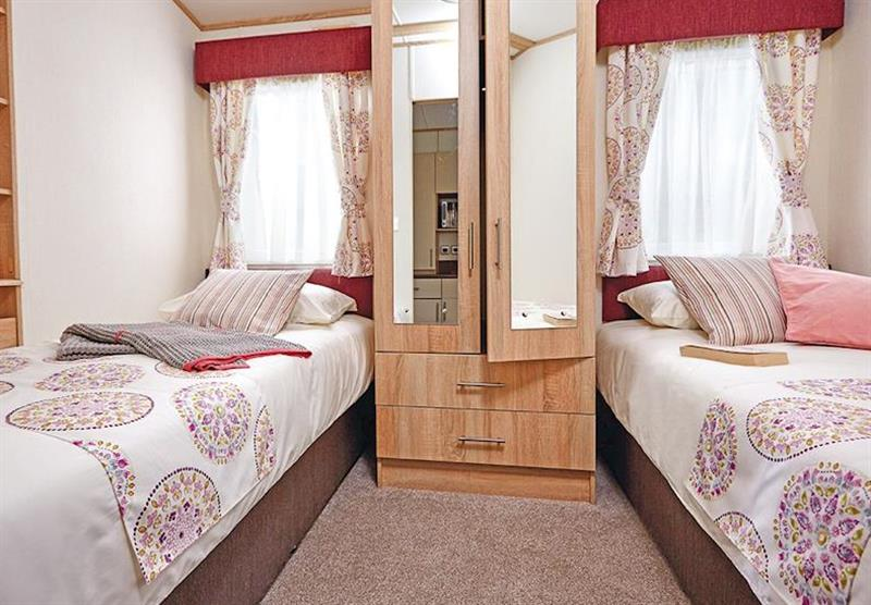 Twin bedroom in the Superior Caravan 2 at Viewfield Manor Holiday Park in Kilwinning, Ayrshire