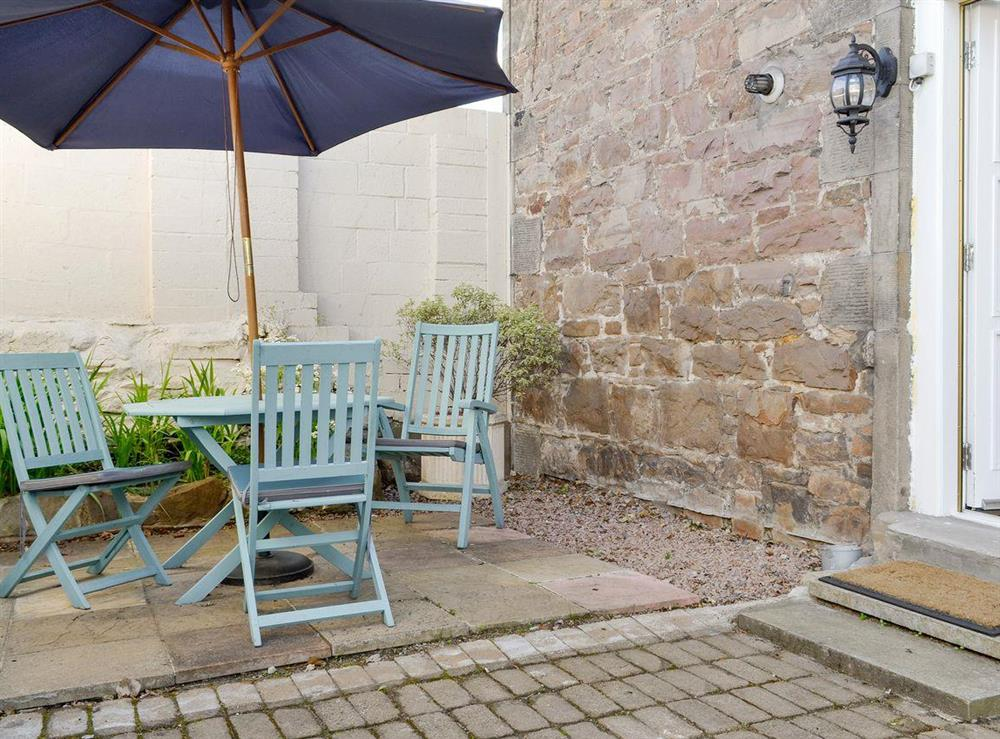 Private patio area with outdoor furniture at Anderson,