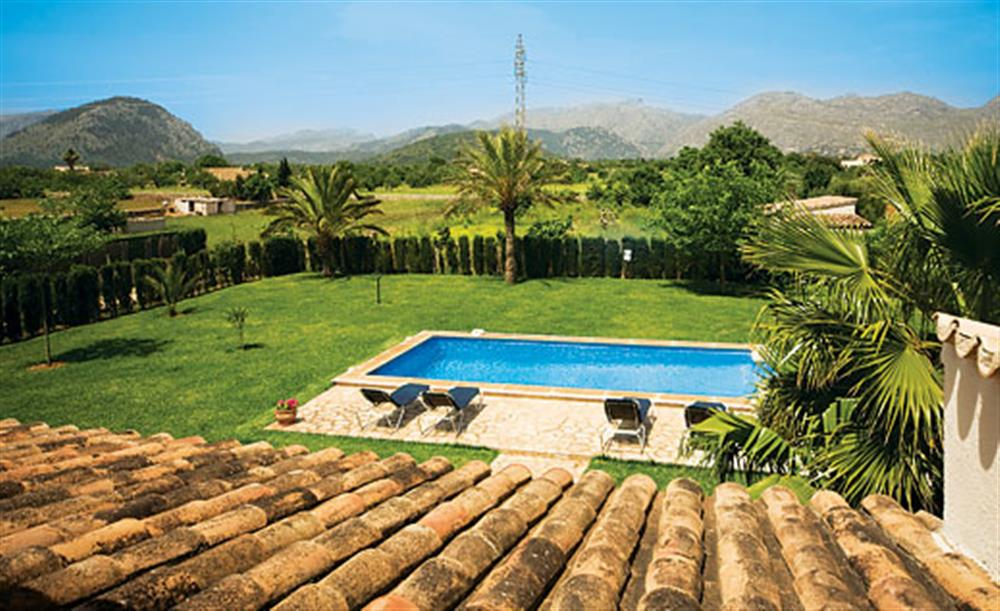 Swimming pool and garden at Villa Antonias , Pollensa Mallorca, Spain