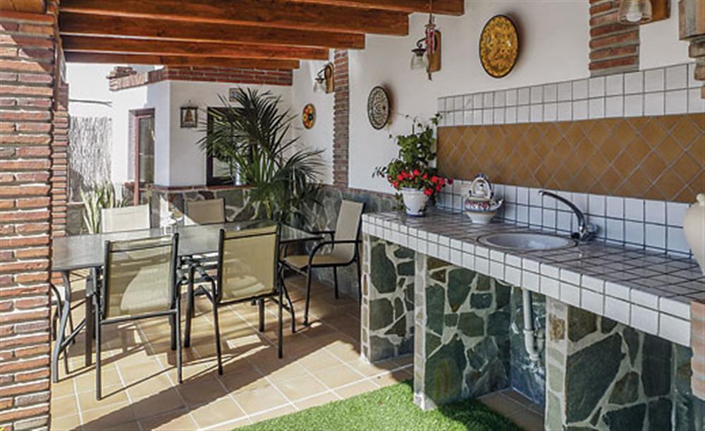 Shaded dining area at Villa Aurora, Nerja Andalucia, Spain