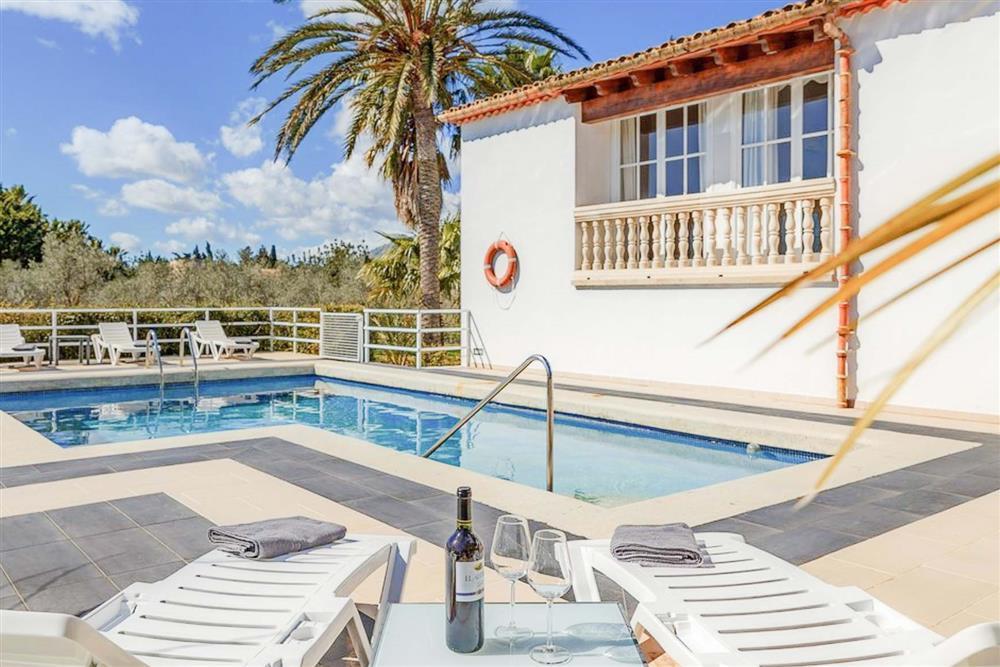 Swimming pool and sun loungers at Villa Can Bobis Gran, Pollensa, Mallorca