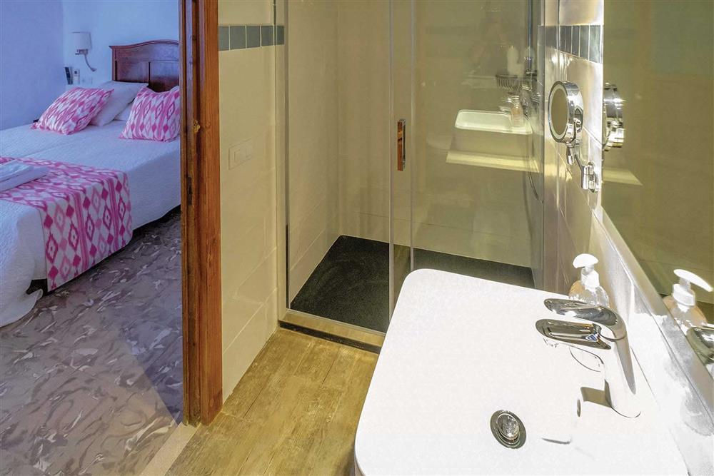 Double bedroom and en suite at Villa Can Butxaca, Pollensa, Mallorca