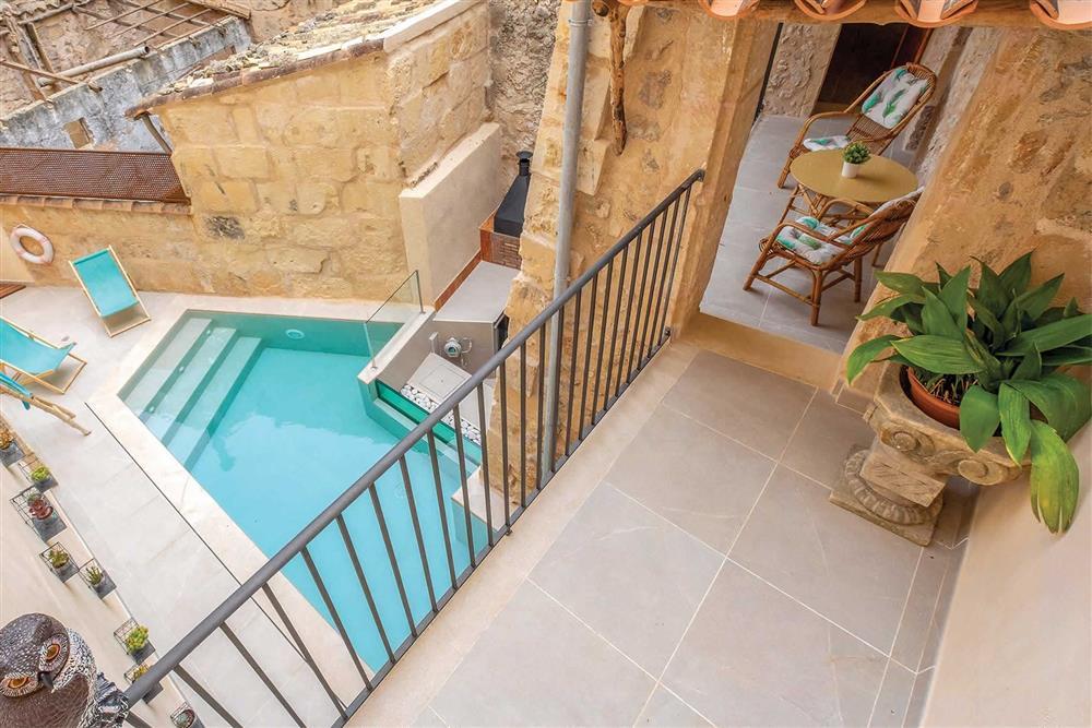 The swimming pool in the garden at Villa Can Butxaca, Pollensa, Mallorca