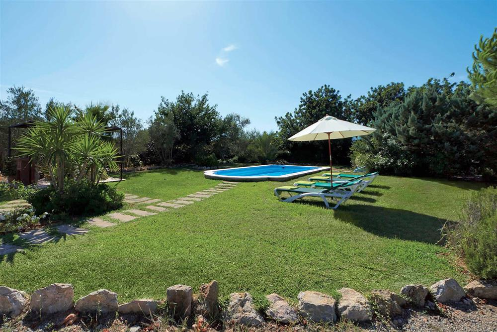 The lawned garden at Villa Can Canaveret, The Balearic Islands, Spain