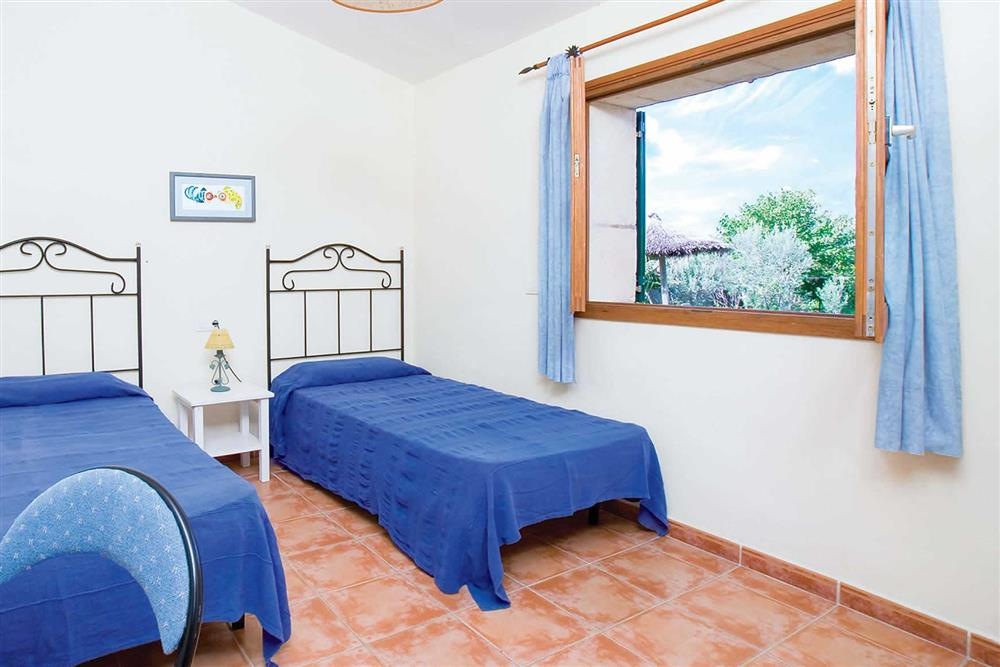 Twin bedroom at Villa Can Canaveret, The Balearic Islands, Spain