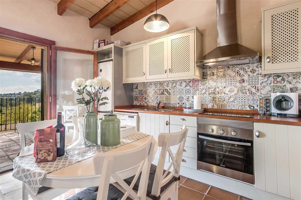 The kitchen and dining area at Villa Can Gardo, Pollensa, Mallorca