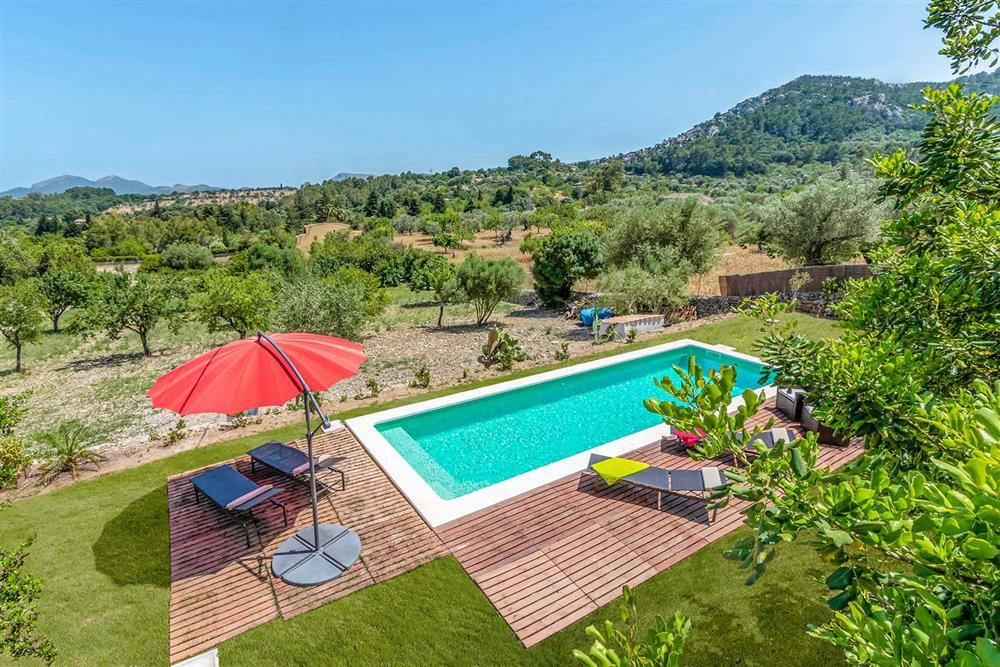 The swimming pool and setting of Villa Can Gardo at Villa Can Gardo, Pollensa, Mallorca