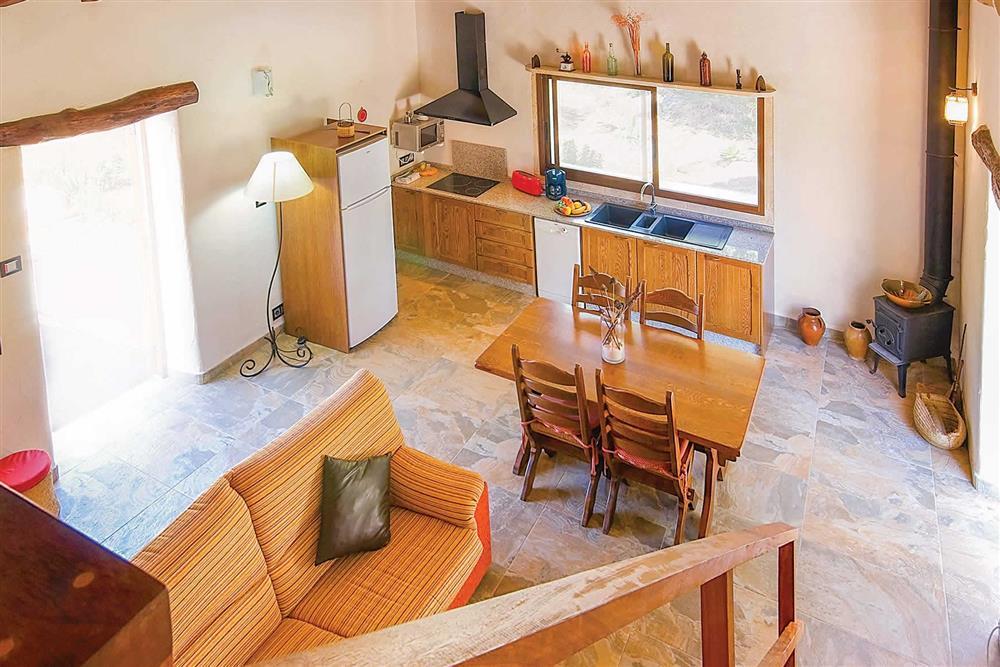Open plan kitchen, dining and living area at Villa Can Nicolau, Cala San Vicente, Mallorca