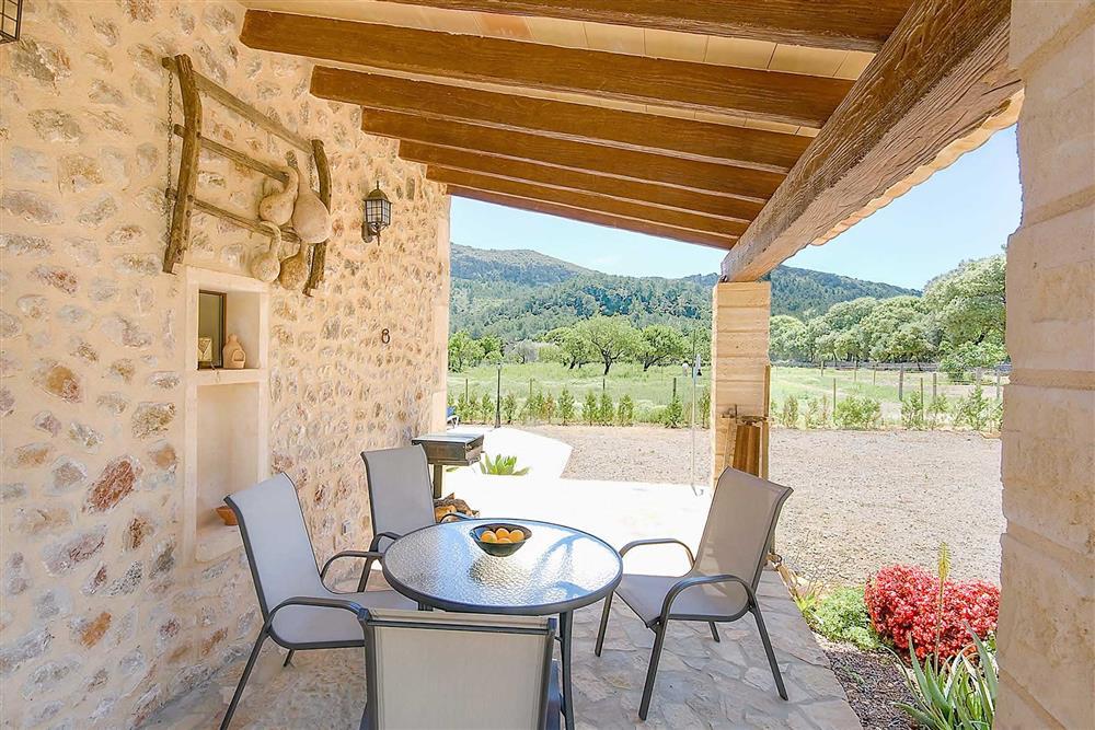 Shaded dining at Villa Can Nicolau, Cala San Vicente, Mallorca