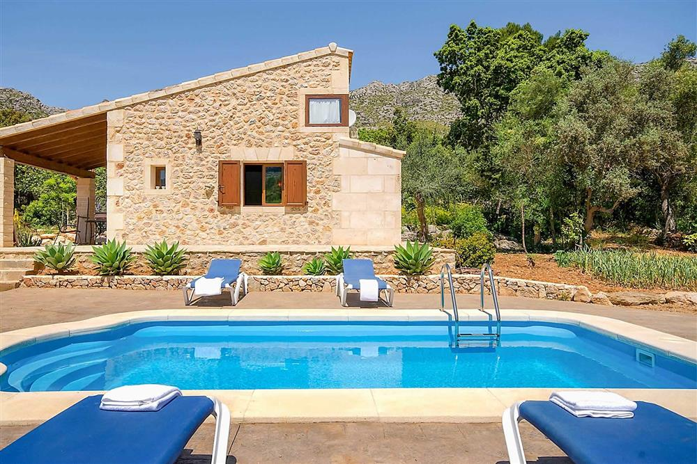 Swimming pool and sun loungers at Villa Can Nicolau, Cala San Vicente, Mallorca