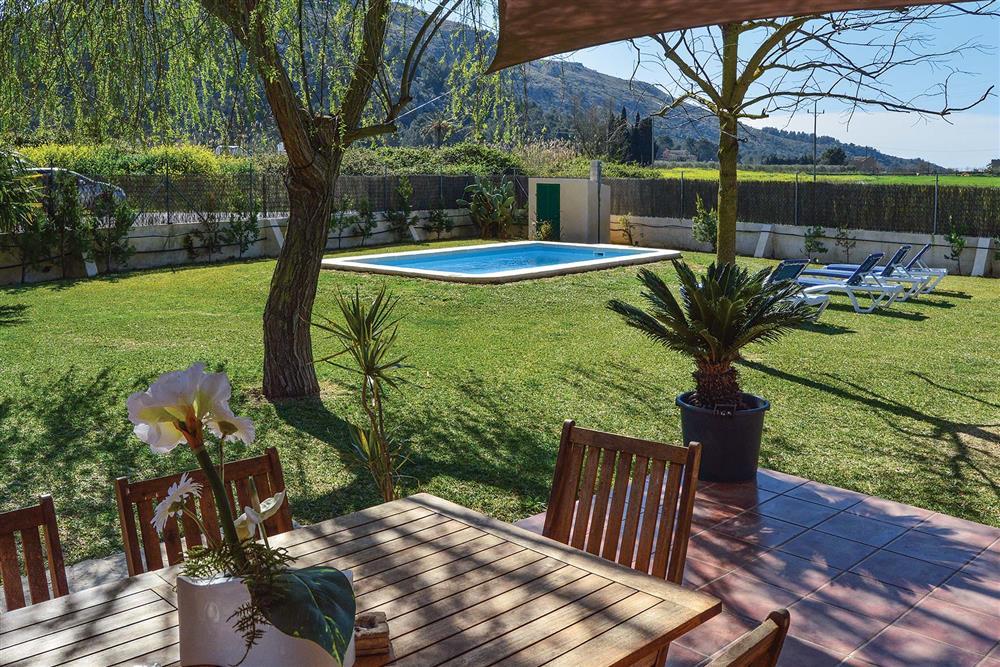 Garden, pool and outdoor furniture at Villa Can Segue, Alcudia, Mallorca