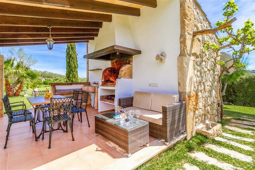 Shaded dining area at Villa Can Segue Dos, Alcudia, Mallorca