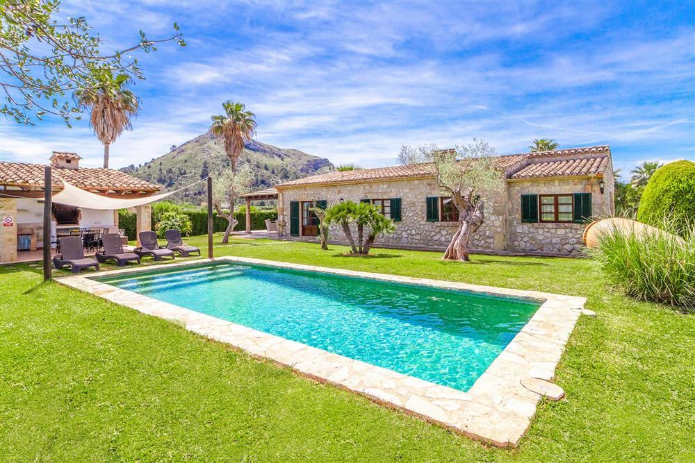 Swimming pool and garden at Villa Can Segue Dos, Alcudia, Mallorca