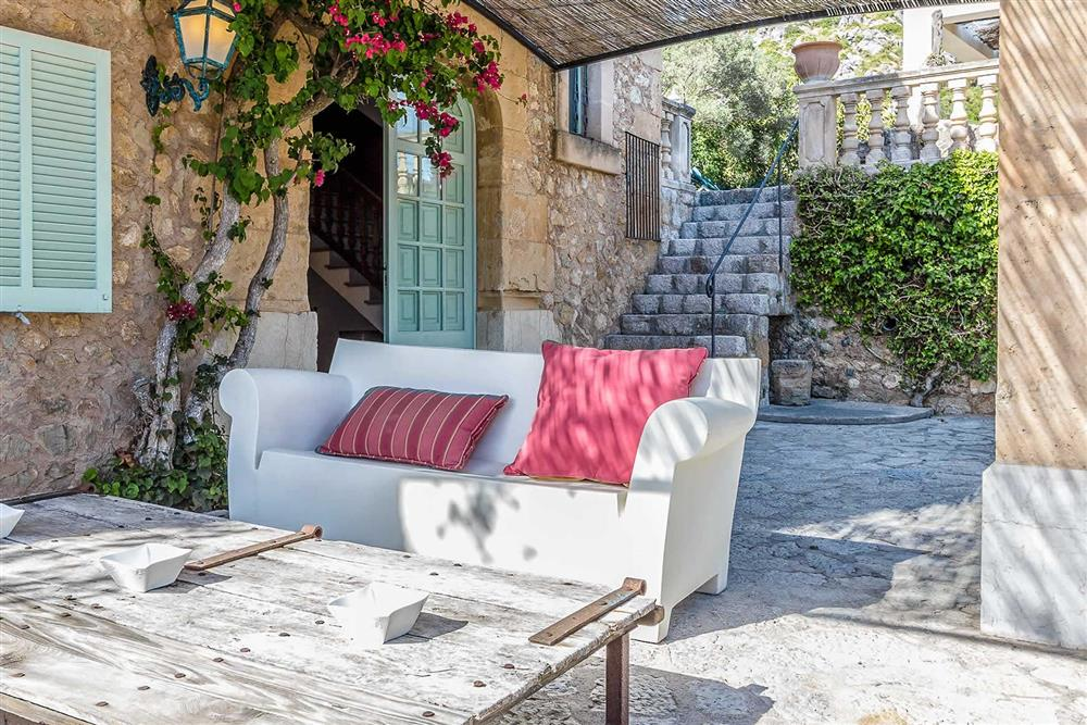 Shaded seating at Villa Can Segui, Puerto Pollensa, Mallorca
