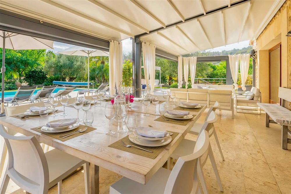 Shaded dining at Villa Canacati, Pollensa, Mallorca