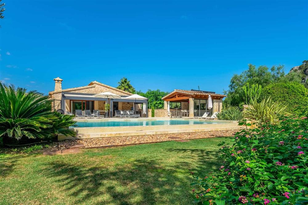The pool and garden at Villa Canacati, Pollensa, Mallorca