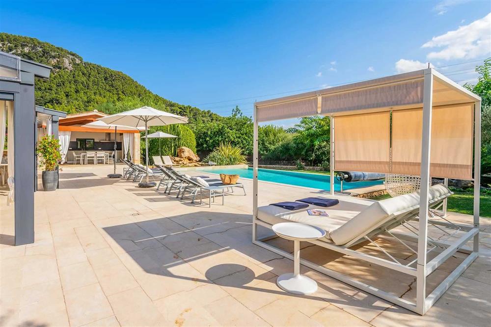 The pool and sun loungers at Villa Canacati, Pollensa, Mallorca