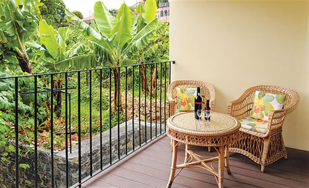 A glass of wine on the balcony at Villa Casa do Feitor, Funchal Madeira, Portugal
