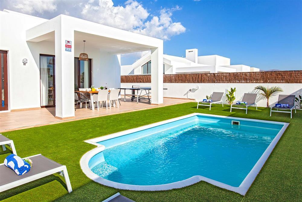 Garden and pool at Villa Cindy, Playa Blanca, Lanzarote