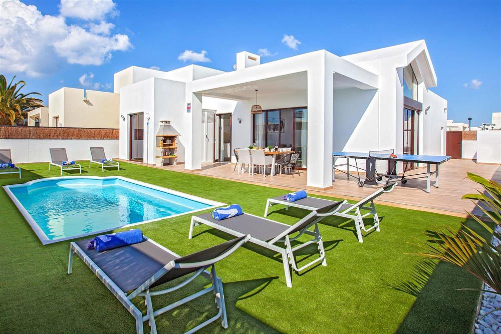 Villa exterior, pool, sunloungers at Villa Cindy, Playa Blanca, Lanzarote