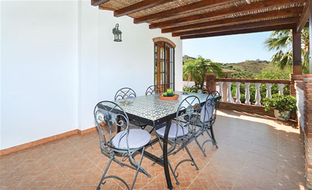 Shaded dining area at Villa Conchi, Frigiliana, Andalucia