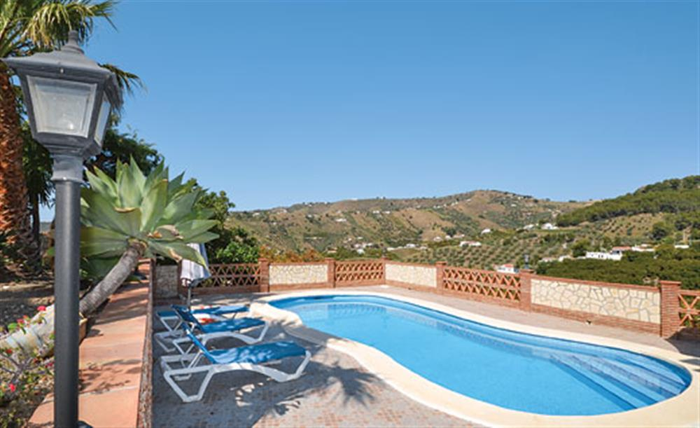 Swimming pool and sun loungers at Villa Conchi, Frigiliana, Andalucia