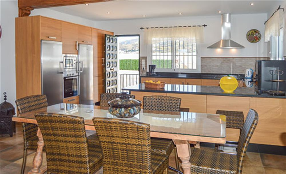 The kitchen and dining area at Villa Cortijo el Olivar, Torrox, Andalucia