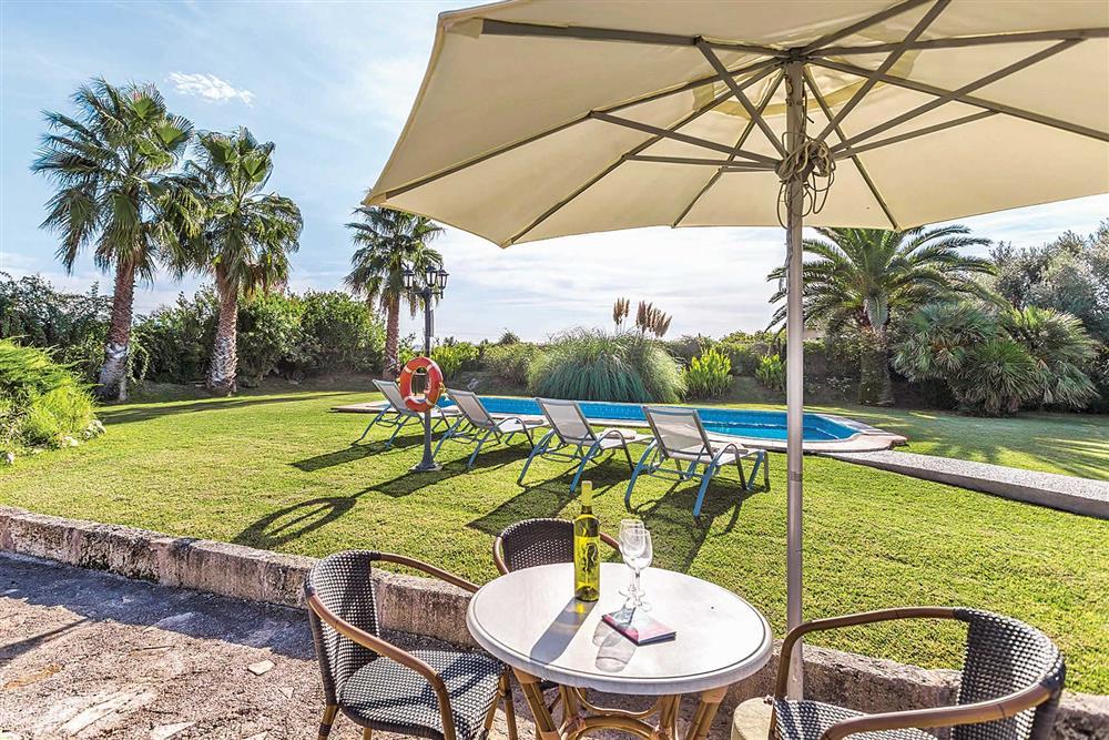Garden, alfresco dining, pool at Villa Cosme, Pollensa, Mallorca, Spain