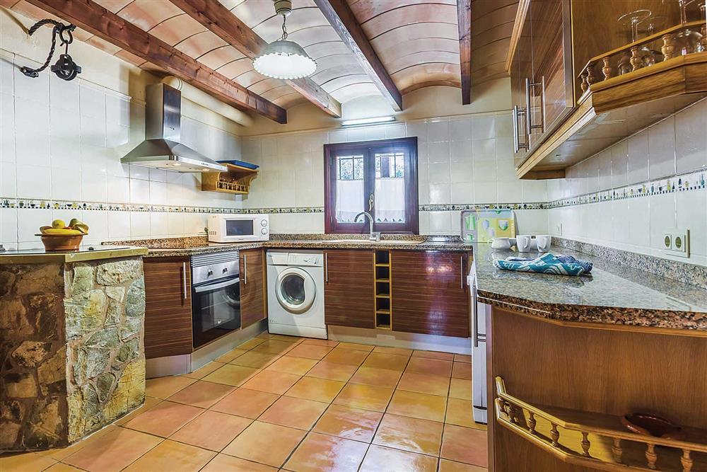 Infinity pool, kitchen at Villa Cosme, Pollensa, Mallorca, Spain