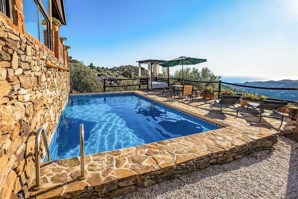 Pool, sunloungers, seating area at Villa El Amigo, Torrox, Andalucia