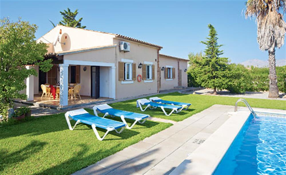 Garden and sun loungers at Villa Isabel, Pollensa Mallorca, Spain
