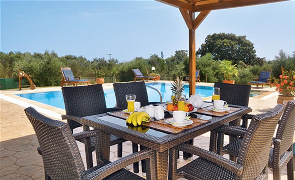 Dining in the shade at Villa Karetta, Lake Korrison Corfu, Greece