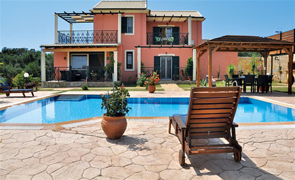 Swimming pool and sun lounger at Villa Karetta, Lake Korrison Corfu, Greece
