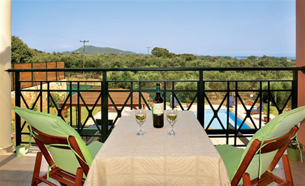 Wine on the balcony at Villa Karetta, Lake Korrison Corfu, Greece
