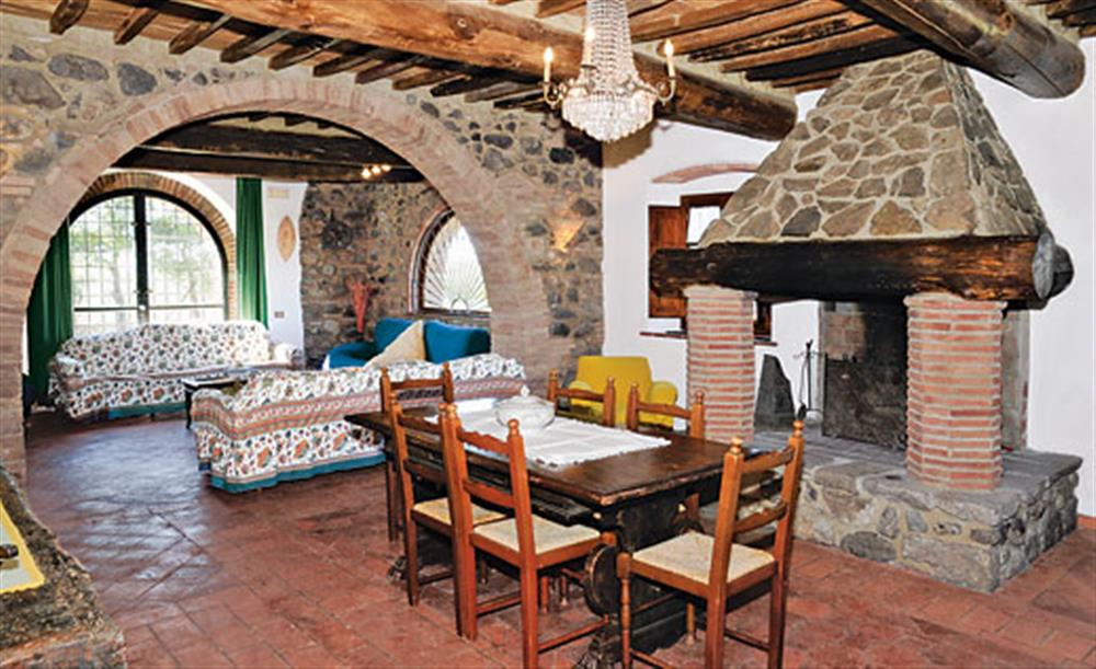 Living room and dining area at Villa La Lespa, Santa Luce Tuscany, Italy