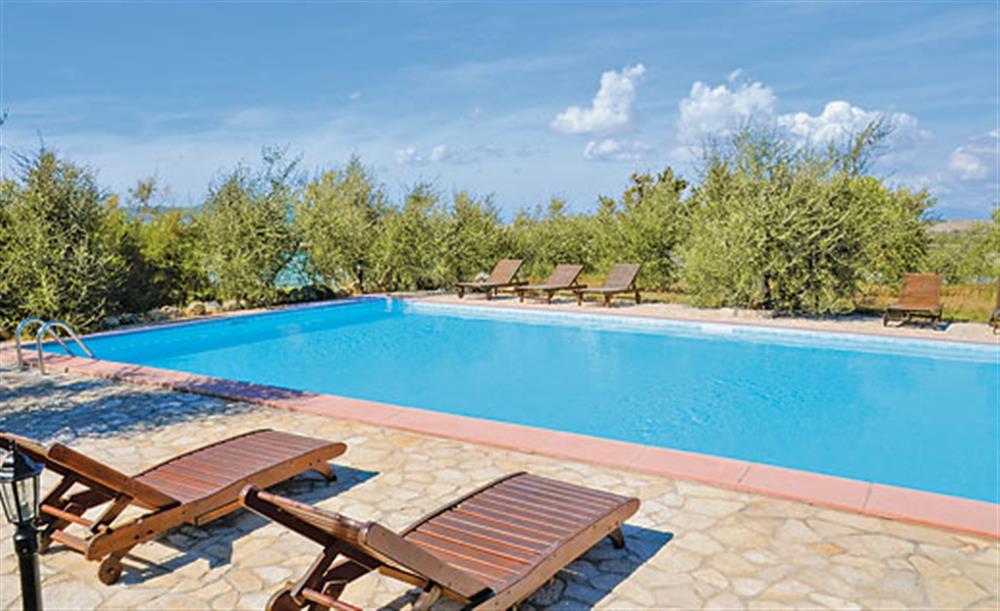 Swimming pool and sun loungers at Villa La Lespa, Santa Luce Tuscany, Italy