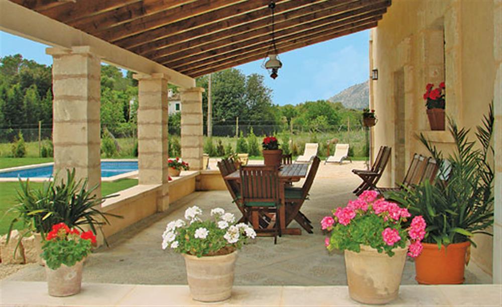 Shaded dining next to the villa at Villa La Nova, Pollensa, Mallorca
