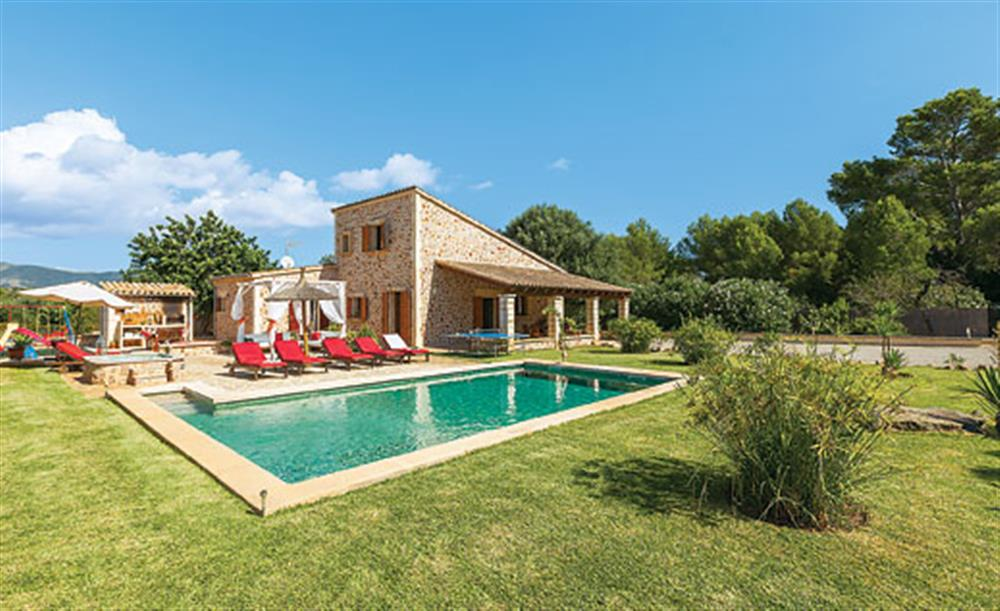 Swimming pool and garden at Villa La Nova, Pollensa, Mallorca