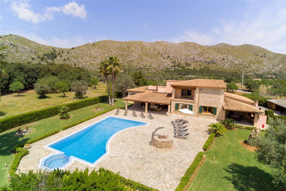 Aerial view, villa exterior, pool at Villa Les Oliveres, Puerto Pollensa, Mallorca