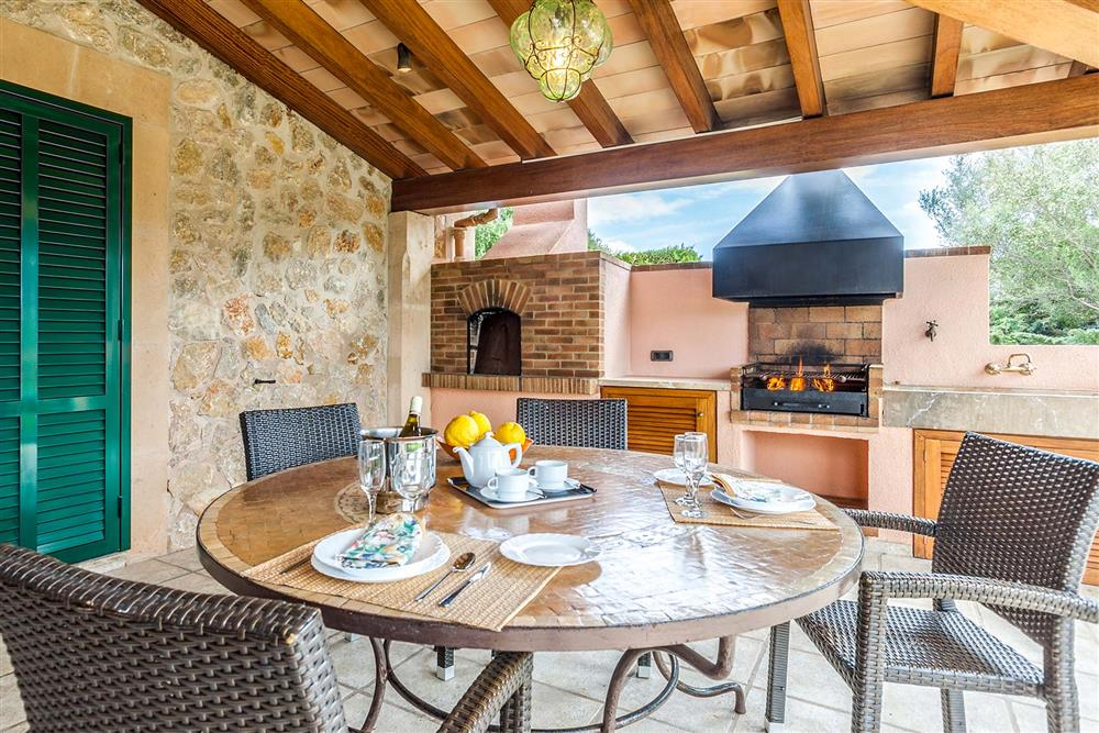 Alfresco dining, barbecue, covered terrace at Villa Les Oliveres, Puerto Pollensa, Mallorca