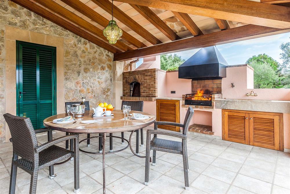 Alfresco dining, covered terrace, barbecue at Villa Les Oliveres, Puerto Pollensa, Mallorca