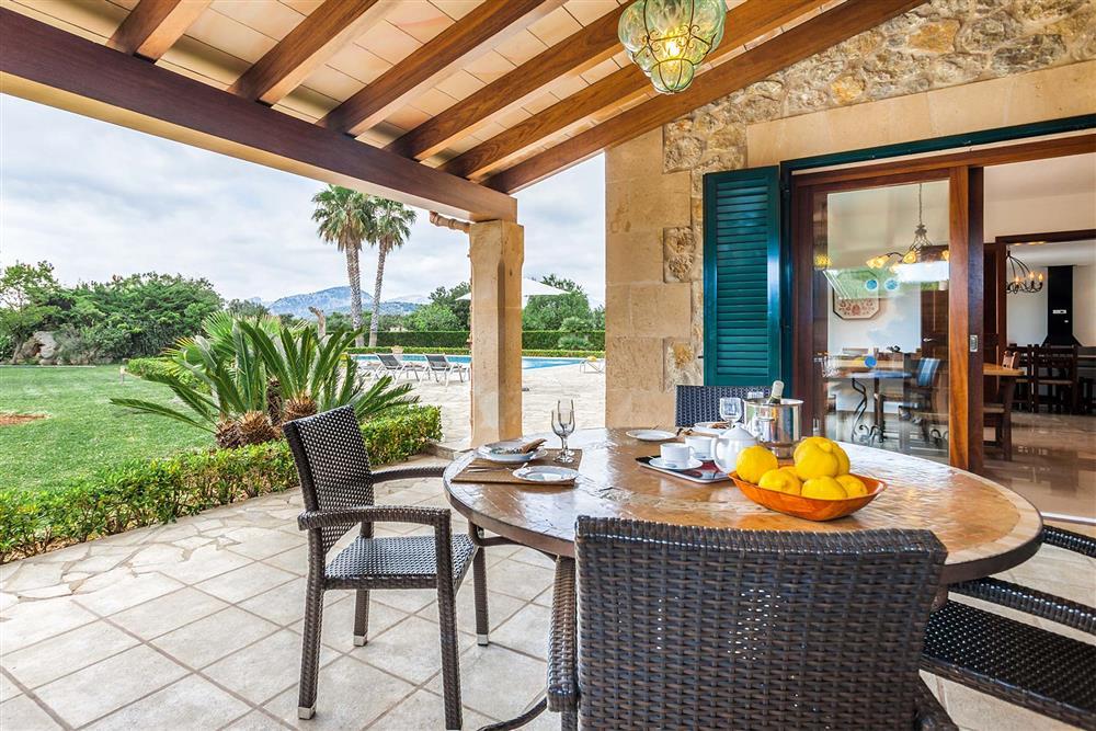Alfresco dining, covered terrace, garden at Villa Les Oliveres, Puerto Pollensa, Mallorca