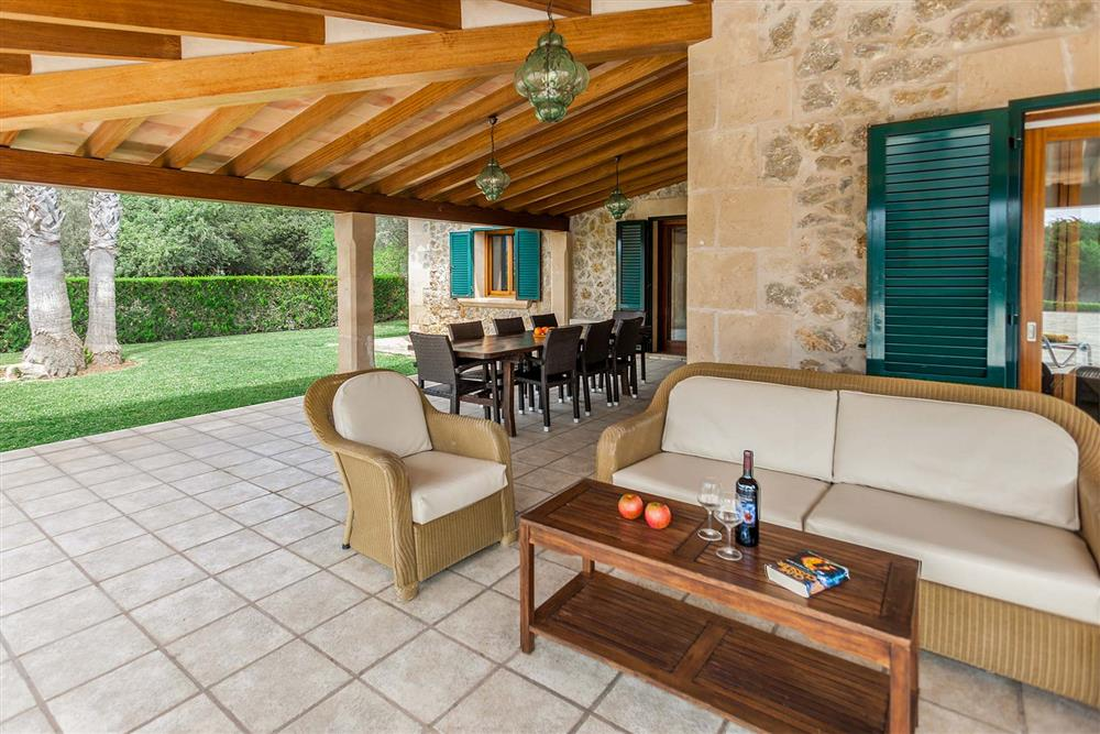 Covered terrace, seating area at Villa Les Oliveres, Puerto Pollensa, Mallorca