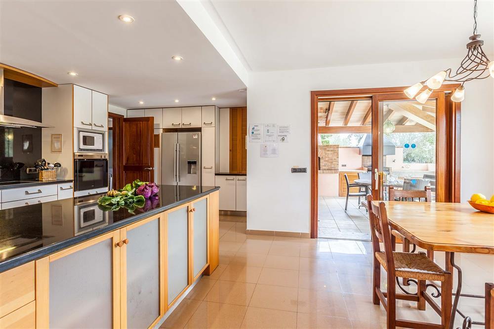 Kitchen, dining room, terrace at Villa Les Oliveres, Puerto Pollensa, Mallorca