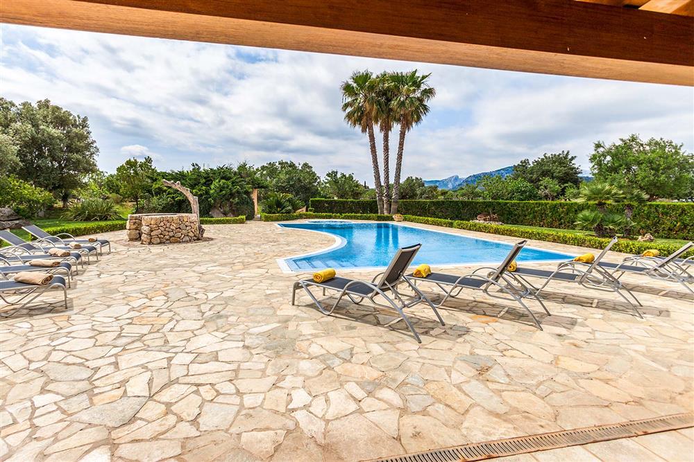Terrace, sunloungers, pool at Villa Les Oliveres, Puerto Pollensa, Mallorca