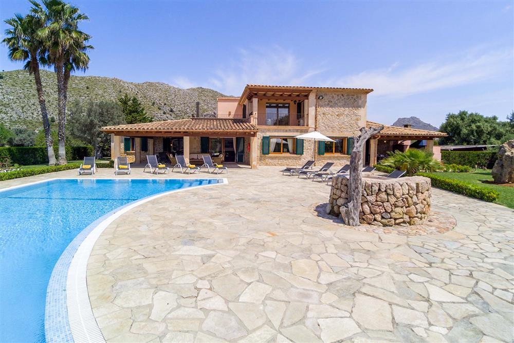 Villa exterior, pool, sunloungers at Villa Les Oliveres, Puerto Pollensa, Mallorca