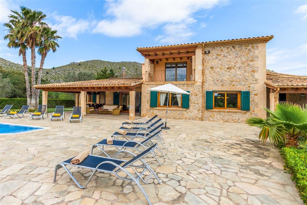 Villa exterior, sunloungers at Villa Les Oliveres, Puerto Pollensa, Mallorca